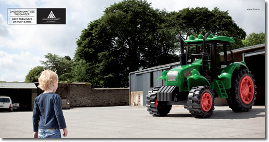 image of child with giant toy tractor