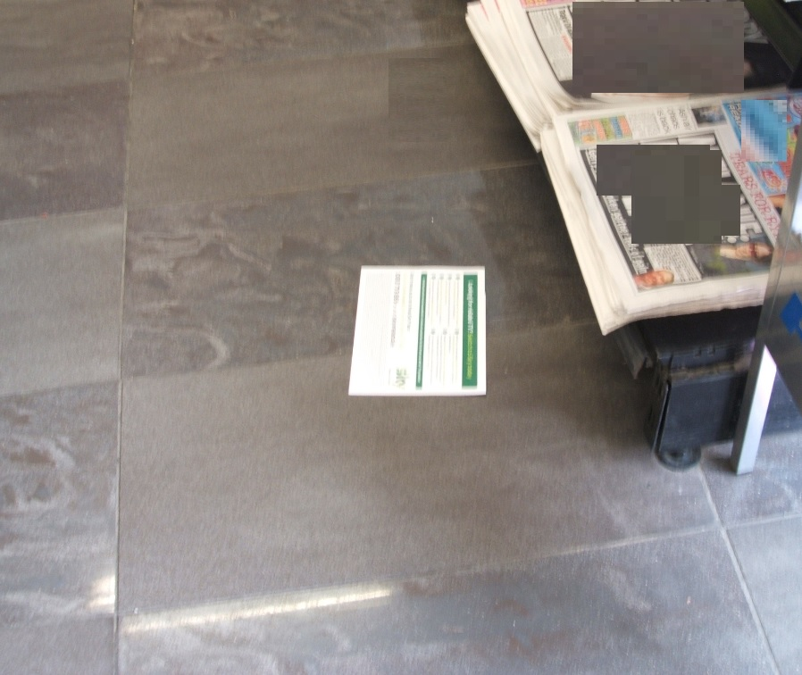 Newspaper insert on floor