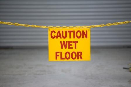 wet floor sign and barrier